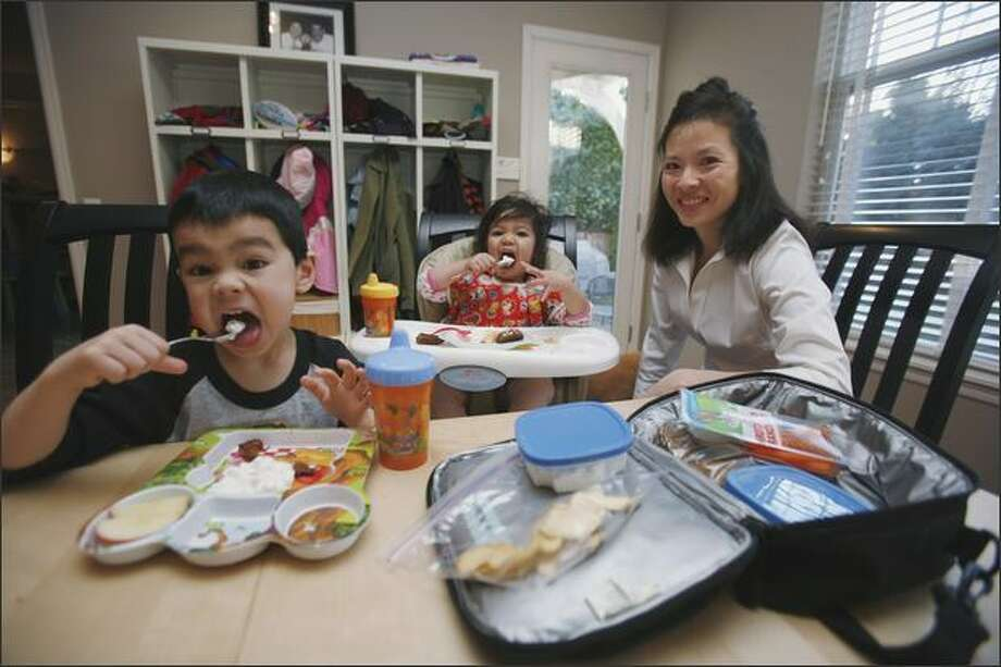 Janet McDevitt and her children, Colin and Alexa, and her husband accepted the challenge last summer to eat primarily locally produced foods. Photo: Paul Joseph Brown, Seattle Post-Intelligencer / Seattle Post-Intelligencer