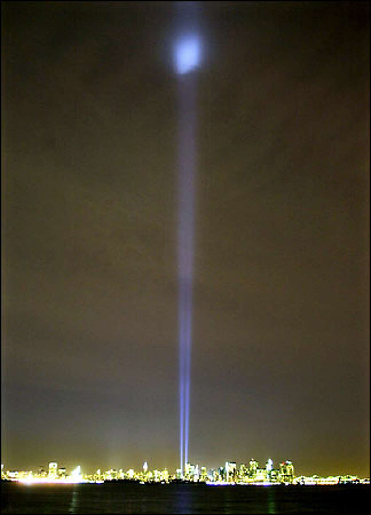 Two beams light up the sky above Manhattan from near the site of the World Trade Center in New York yesterday.