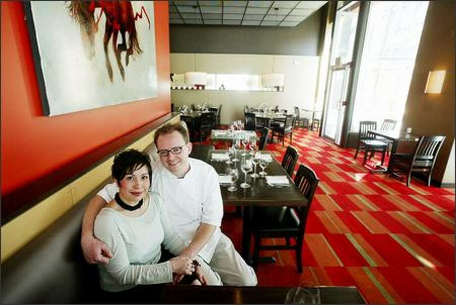 Co-owners Michelle Rasnic and chef Ethan Stowell relax in the dining room of their downtown restaurant Union. The contemporary and colorful atmosphere is calming. Photo: Dan DeLong, Seattle Post-Intelligencer / Seattle Post-Intelligencer