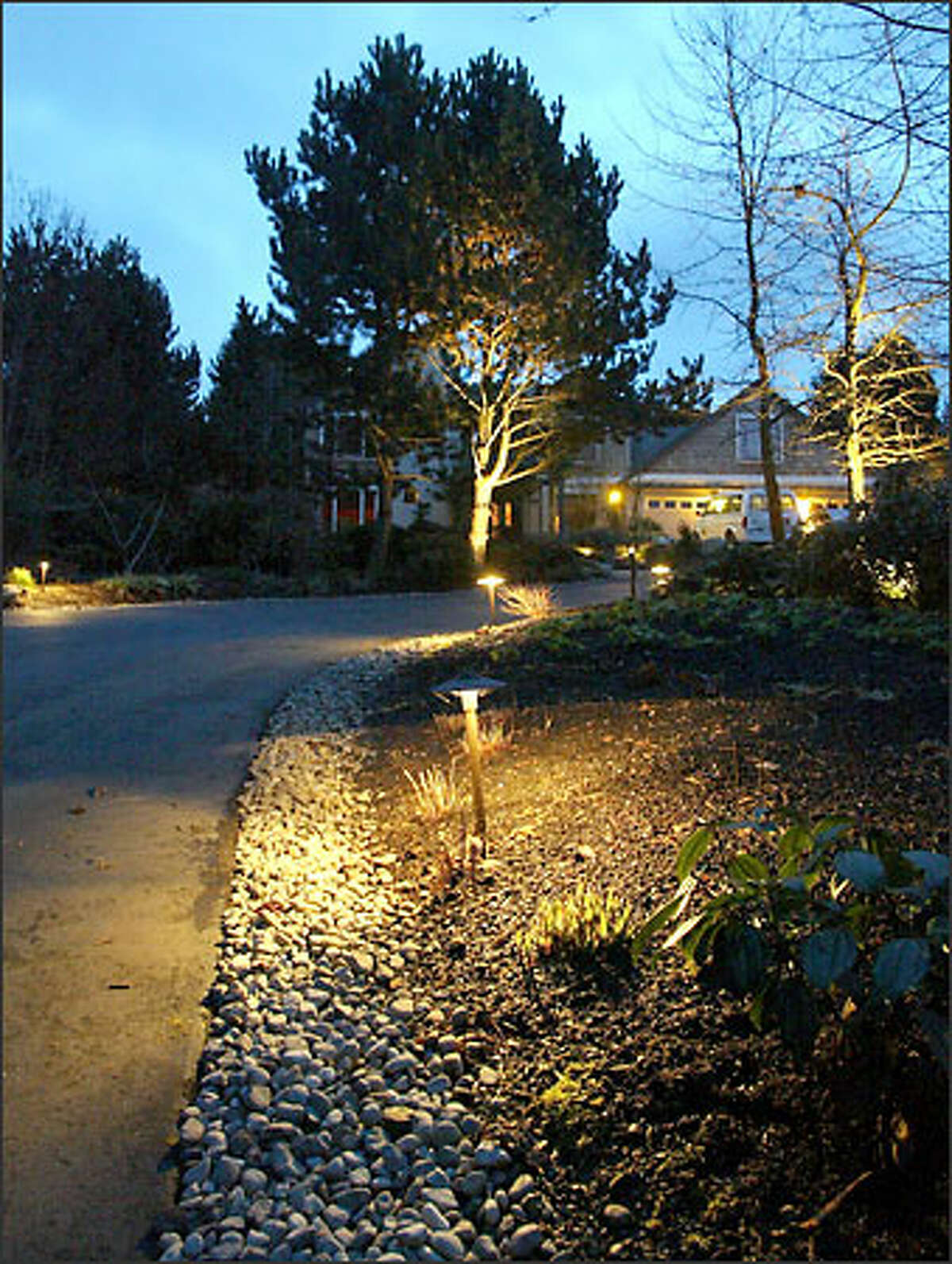 More low-voltage lighting along the main driveway of the Ager home provides safety illumination as well as artistic effects. The lighting layout was created by the designers at Yard Moods in Monroe.