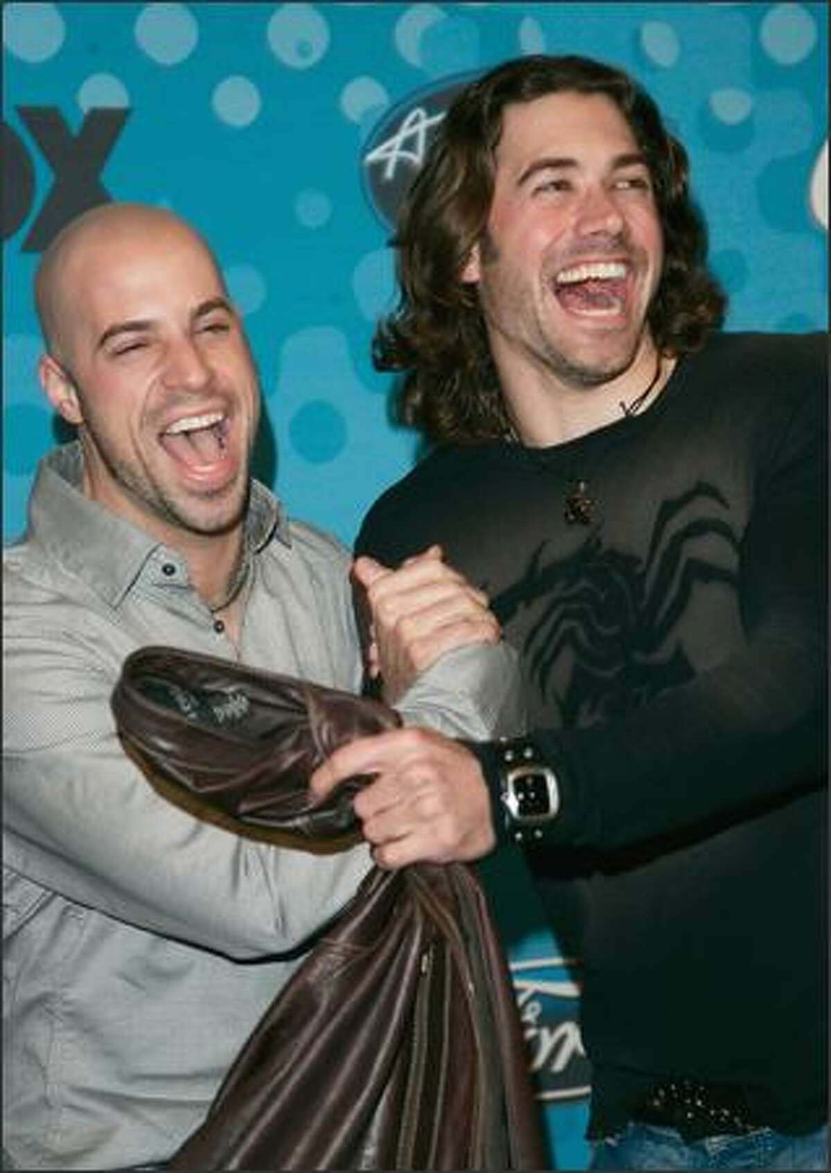 """""""American Idol"""" contestants Chris Daughtry, 26, and Ace Young, 25, are happy campers at the """"American Idol"""" Final 12 Party in Hollywood on Thursday. The party included a reunion for season four contestants (and long-haired rockers) Constantine Meroulis and Bo Bice."""