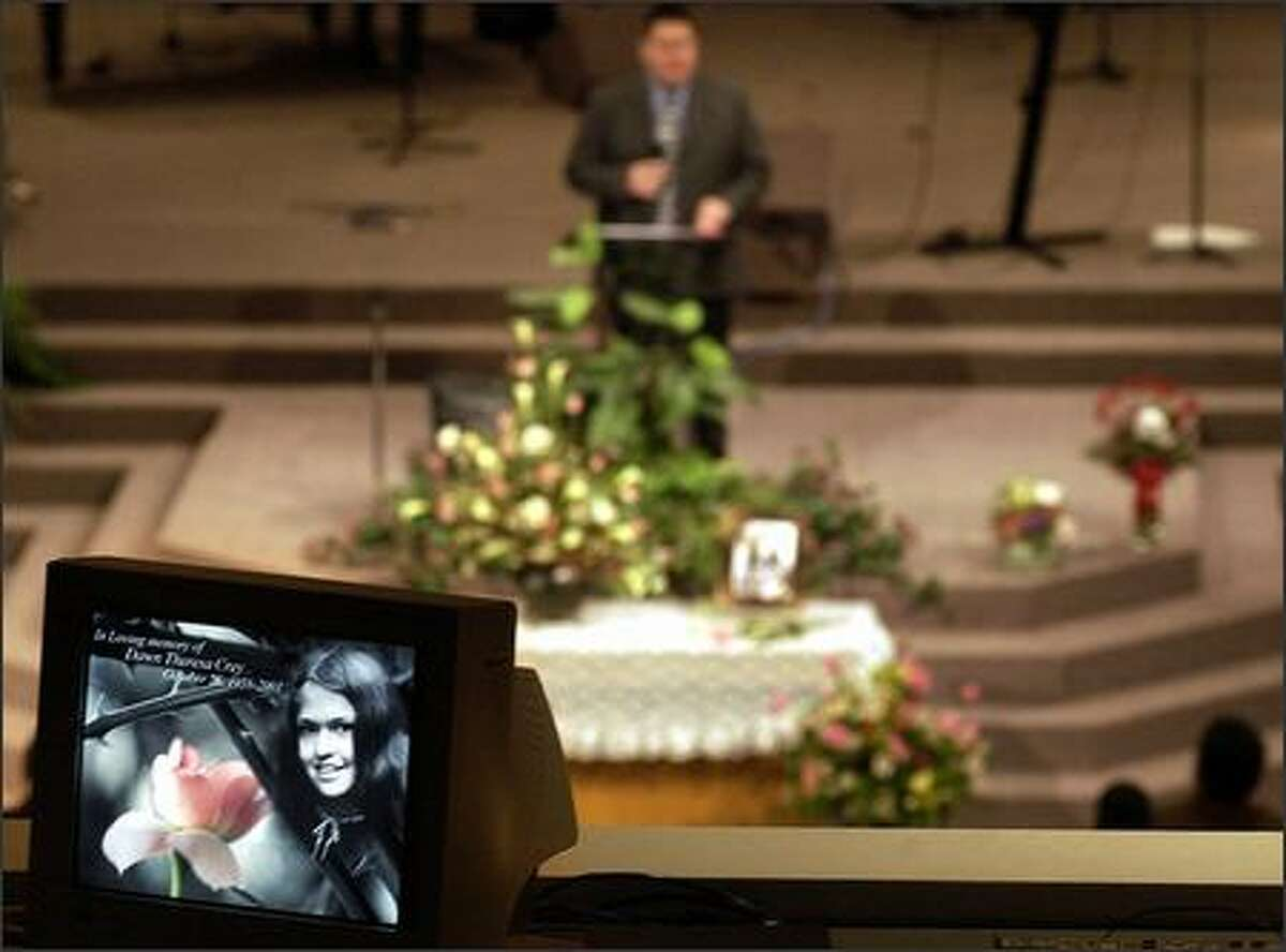 A TV monitor carries a picture of Dawn Crey as Chief Doug Kelly of the Cheam Band of the Sto:lo tribe speaks at her memorial service Feb. 2, 2004, at Christian Assembly Church in Chilliwack, B.C. (PETER BATTISTONI / VANCOUVER SUN)