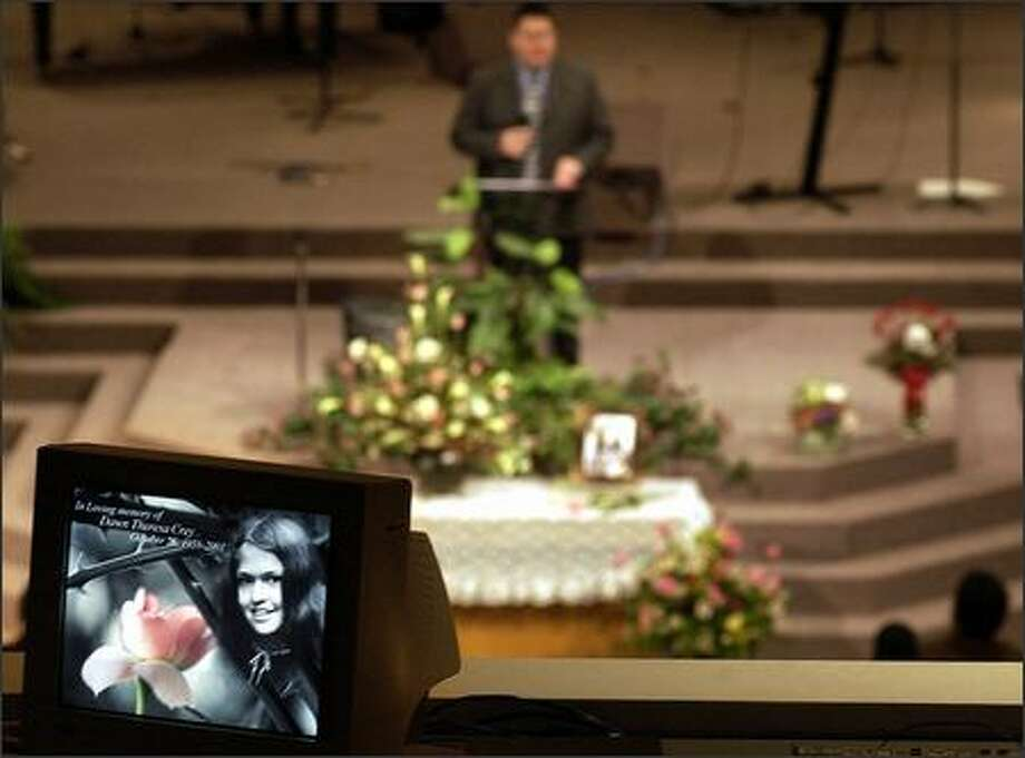 A TV monitor carries a picture of Dawn Crey as Chief Doug Kelly of the Cheam Band of the Sto:lo tribe speaks at her memorial service Feb. 2, 2004, at Christian Assembly Church in Chilliwack, B.C. (PETER BATTISTONI / VANCOUVER SUN) Photo: Mike Urban, Seattle Post-Intelligencer / Seattle Post-Intelligencer