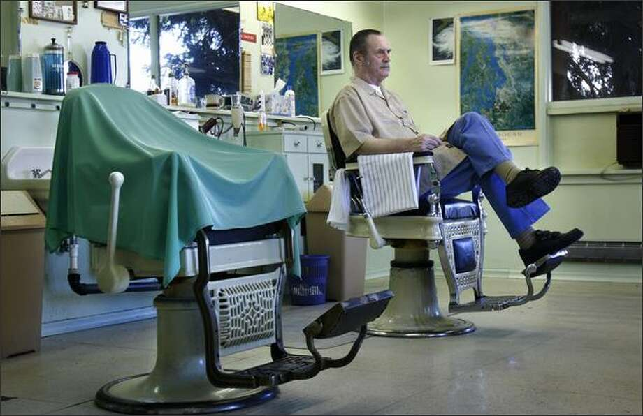 "Mike Sharp, a barber for 50 years, is closing his Tree House Barber Shop in Maple Leaf at the end of the month. Sharp's father Blaine opened the shop in 1953 – then known as Sharp's Barbershop – with Mike taking over when his father retired. ""It's been my place for a long time,"" said Sharp, 73. ""It really hasn't sunk in that I don't own it anymore."" Sharp is also selling the two barber chairs, which are older than he is. Photo: Andy Rogers, Seattle Post-Intelligencer / Seattle Post-Intelligencer"