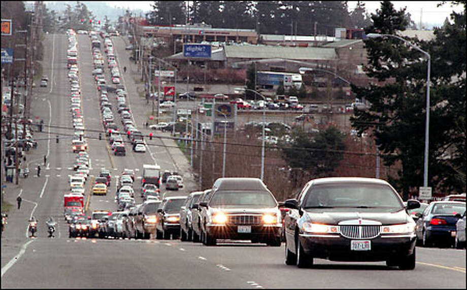 The funeral procession for slain Des Moines police officer Steven Underwood heads north on Pacific Highway South on its way to the cemetery. Thousands attended a memorial service for Underwood, who was killed in the line of duty last week. Photo: Scott Eklund, Seattle Post-Intelligencer / Seattle Post-Intelligencer