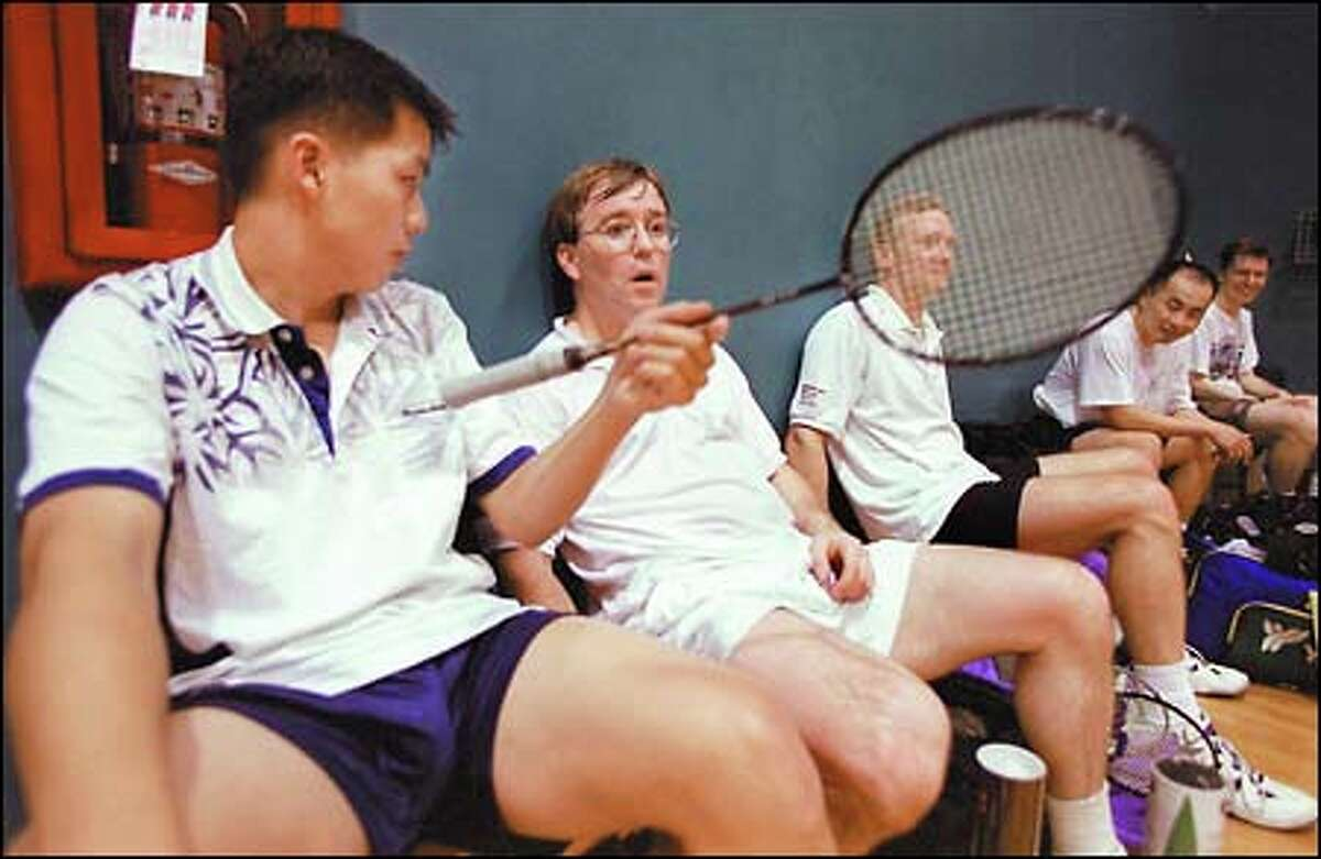 Kenny Lu, left, of Kenmore, and Bellevue resident Geoff Stensland rest up after a game at the Seattle Badminton Club. More than 500 people compete at various levels in the Seattle area.