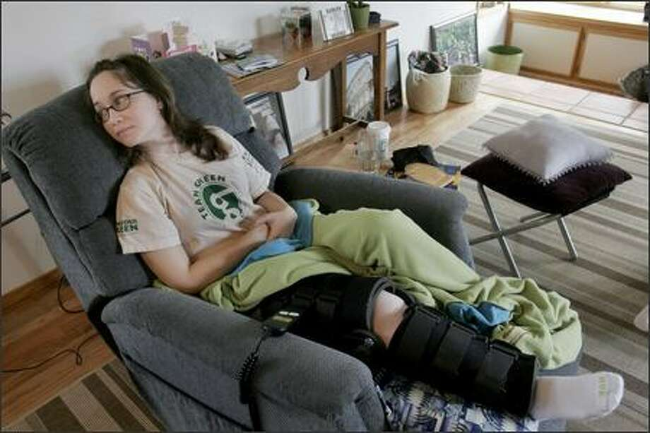 Emily Lovelett was seriously injured when a car hit her at the corner of Southwest 100th Street and 35th Avenue Southwest. The vehicle didn't stop, and the police are looking for the driver. Photo: Meryl Schenker, Seattle Post-Intelligencer / Seattle Post-Intelligencer