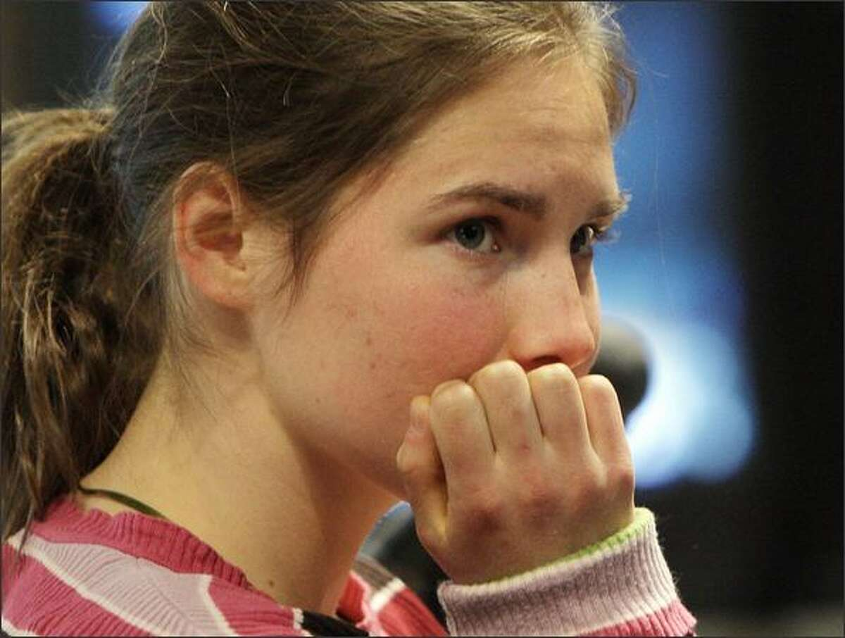 Amanda Knox waits for the start of the Meredith Kercher murder trial at the courthouse in Perugia, Italy, on Friday, March 13, 2009. Knox, 21, and her former Italian boyfriend Raffaele Sollecito, 24, have been charged with the murder of 21-year-old British student Meredith Kercher, who was killed on Nov. 1, 2007 in Perugia.