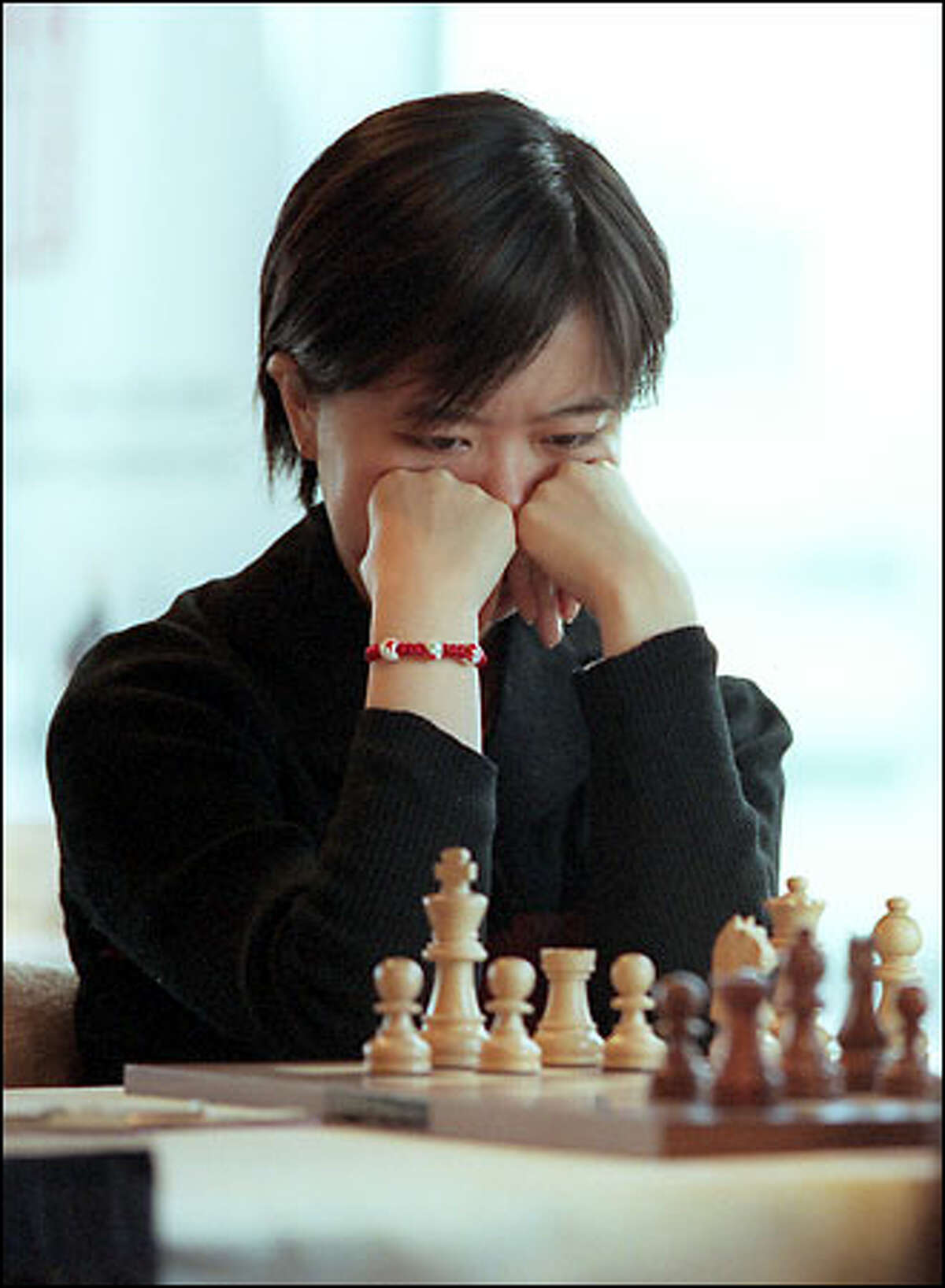 China's women chess players, such as grandmaster Xu Yuhua, are especially strong. Yuhua keeps her eyes on the board during yesterday's game against international master Irina Krush.