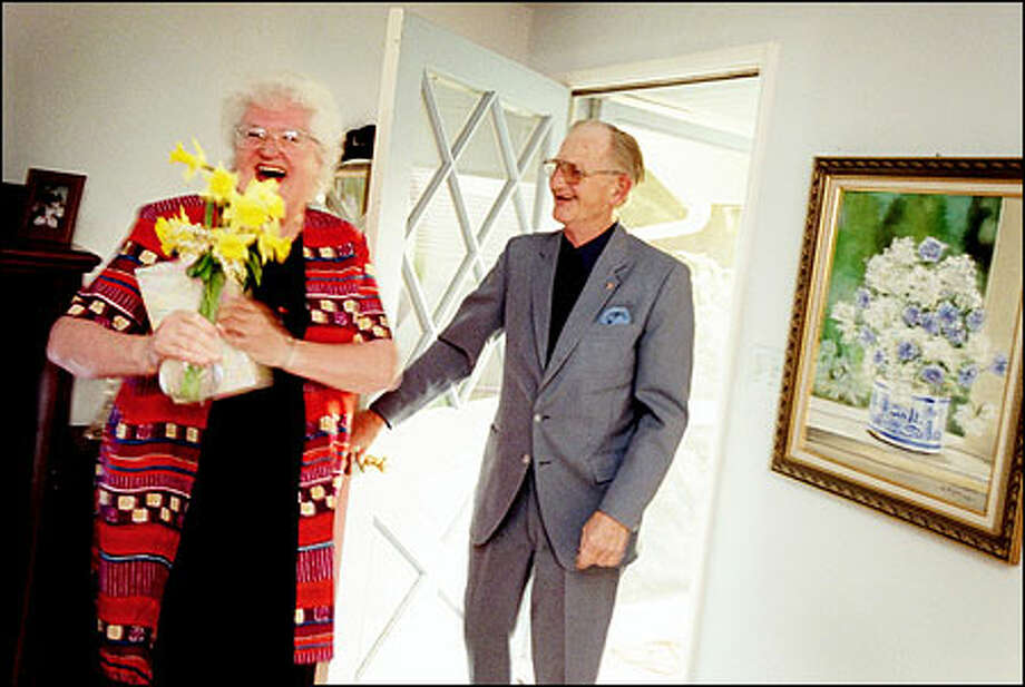 Don Olson showed up at Joan Bjeletich's house with daffodils from his garden. When she asked how he knew she liked daffodils, he said he could read her mind already. Photo: Joshua Trujillo, Seattlepi.com / seattlepi.com