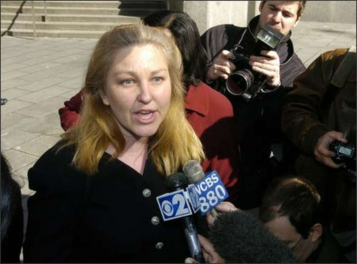 Susan Lindauer speaks to the media outside Manhattan federal court in New York. The one time journalist and congressional aide is accused of secretly becoming an Iraqi intelligence agent. (AP Photo/ Richard Drew)