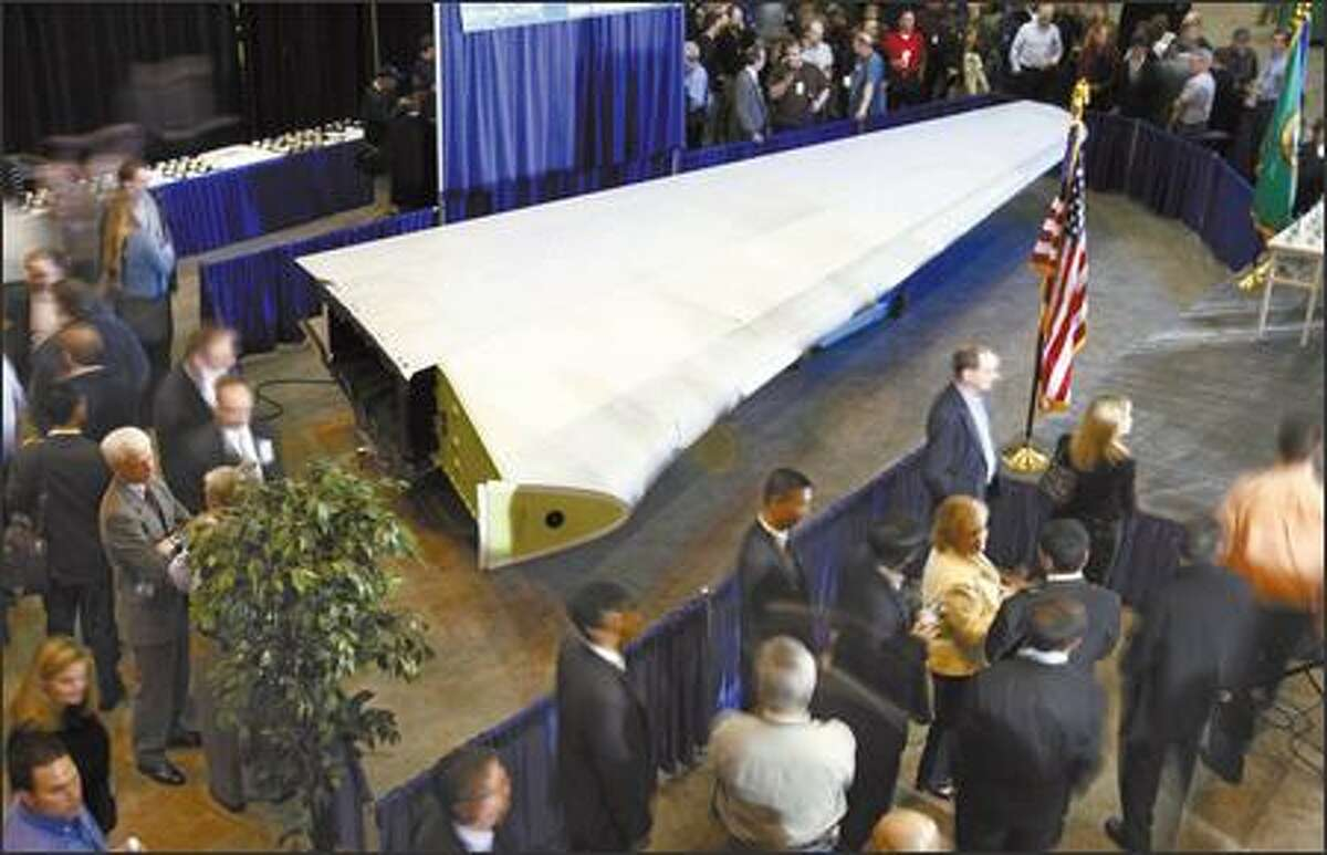 The first completed 787 tail fin takes center stage at a celebration Wednesday at Boeing's Composite Manufacturing Center in Frederickson.