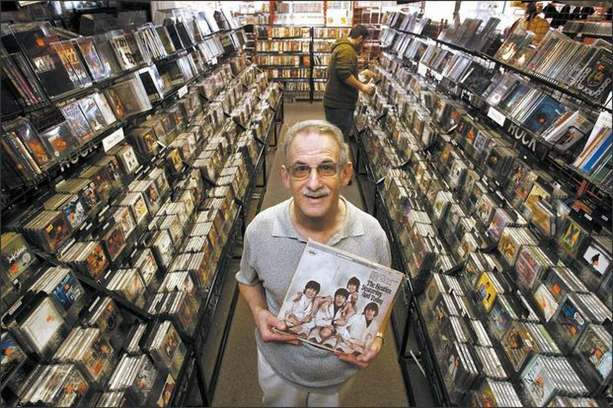 Barry Reisman, owner of music store Soundsations in Issaquah, poses recently with
