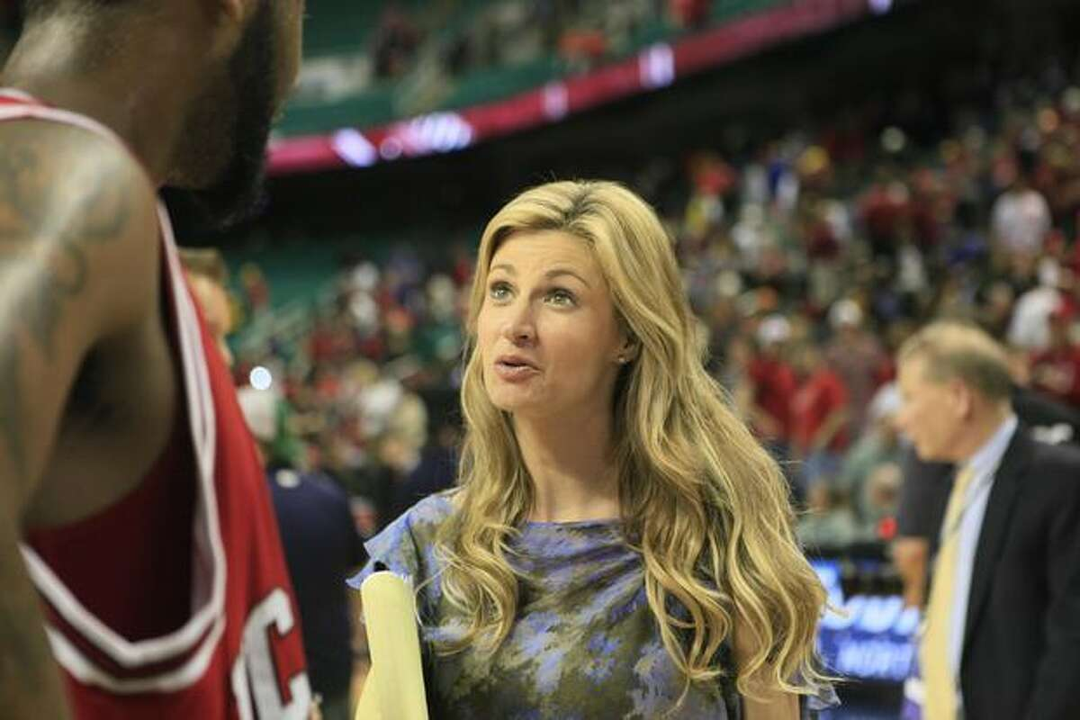 This photo made last Friday shows ESPN sportscaster Erin Andrews interviewing North Carolina State's Tracy Smith after a college basketball game at the Atlantic Coast Conference tournament in Greensboro, N.C. The man convicted of stalking Andrews and shooting nude videos of her through a hotel room peephole was sentenced Monday to 2 1/2 years in prison. (AP Photo/Gerry Broome)