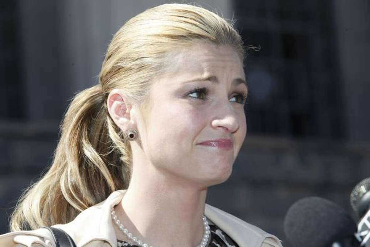 ESPN reporter Erin Andrews gives a news conference on the sentence of her stalker outside U.S. District Court in Los Angeles on Monday. Michael Barrett, who secretly made nude videos of Andrews, was sentenced Monday to 2 1/2 years in prison before giving a tearful apology that was harshly rebuked by his victim. (AP Photo/Damian Dovarganes)