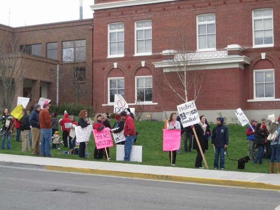 Community members protest outside the San Juan County courthouse in Friday Harbor on Tuesday, March 15, 2011, after learning that a Level 3 sex offender has requested to move into the area.