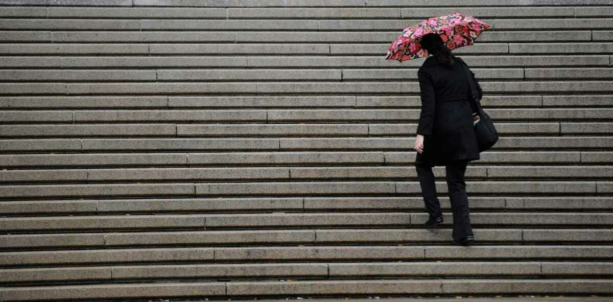 A person climbs the steps of the Education Building in Albany, New York, on April 5, 2011 on a blustery day. (Skip Dickstein / Times Union)