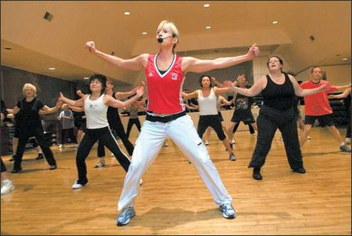 At her Pro-Robics gym on Queen Anne, Kari Anderson leads her high-energy aerobics class called Hi-Lo.