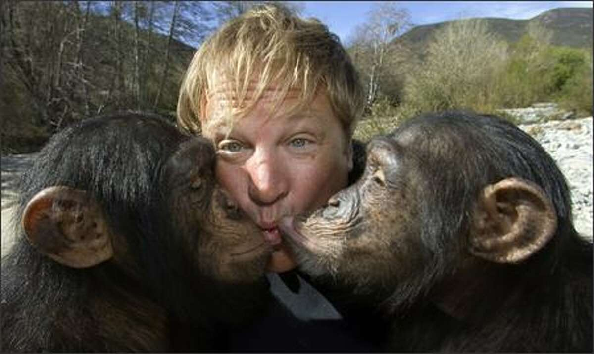 """""""I'd kiss you if you weren't so ugly"""" apparently doesn't apply to the chimps who are smooching Hollywood animal trainer Sid Yost. In this """"Planet of the Apes"""" world, humans treat their simian friends nicely, even if the No Reel Apes campaign says otherwise. They want to sub in CGI for real monkeys, like in """"King Kong."""""""