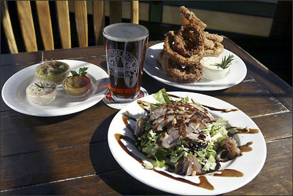 At Jolly Roger Taproom executive chef David Miller serves Smokers (smoked and fried onion rings) and tea-smoked duck Napoleon.
