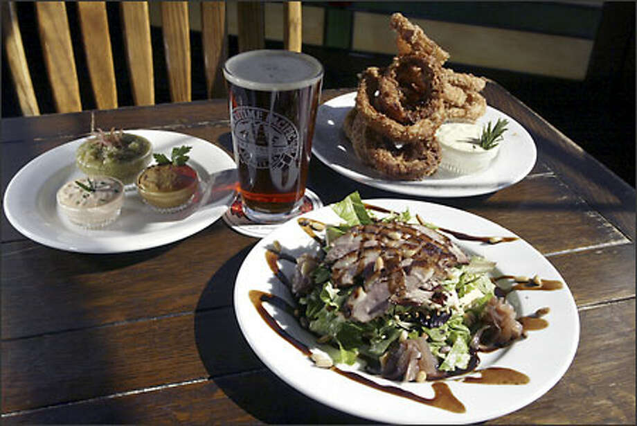 At Jolly Roger Taproom executive chef David Miller serves Smokers (smoked and fried onion rings) and tea-smoked duck Napoleon. Photo: Jim Bryant, Seattle Post-Intelligencer / Seattle Post-Intelligencer