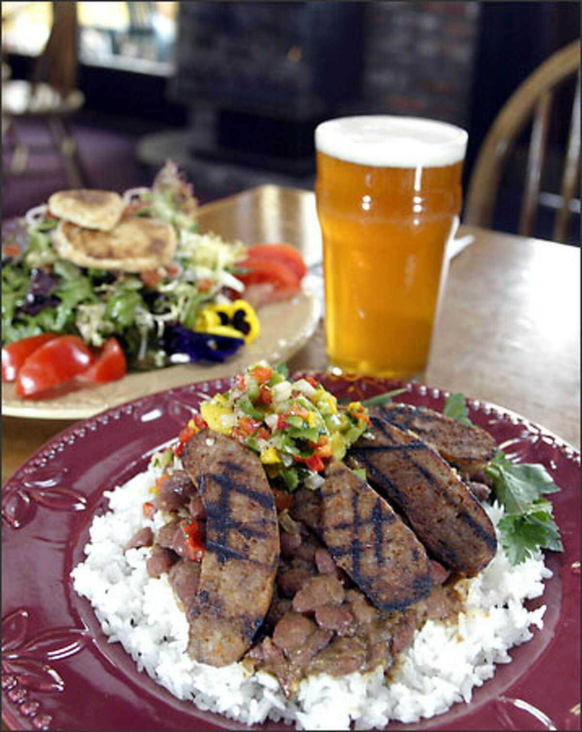 At Hilltop Ale House it's red beans and rice with andouille sausage and an organic goat cheese salad served with Snoqualmie Wildcat IPA.