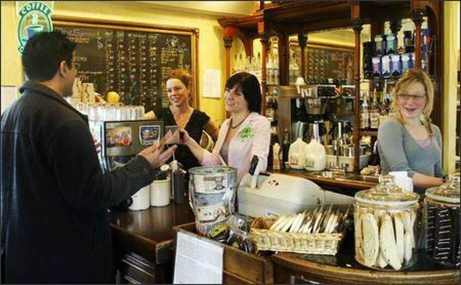 Diva customer Karri Norton, left, talks with baristas Laura Krejsa, rear left, Krystle Dyksterhuis, center, and Margaret Dybash, right. Photo: Gilbert W. Arias, Seattle Post-Intelligencer / Seattle Post-Intelligencer