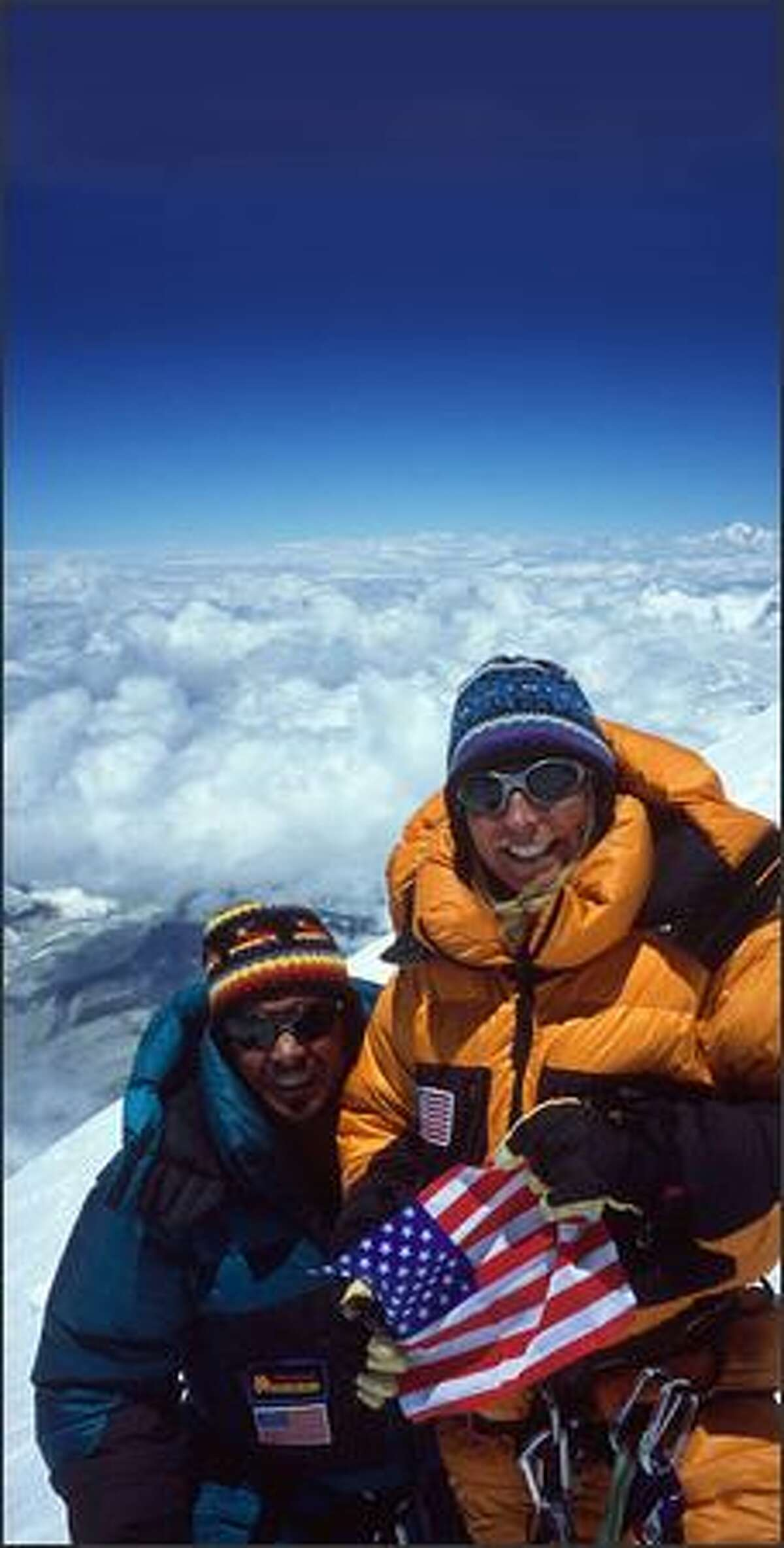 Phil and Sue Ershler of Kirkland stand on top of the world, 29,035-foot Mount Everest, on May 16, 2002.