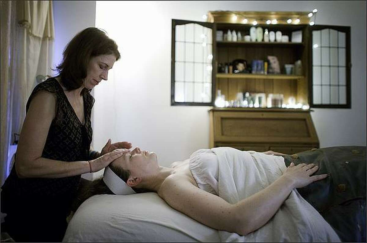 Lisa Steele, owner of Cassie's Place Skin Care, gives a facial to Barbara Sweeney on Saturday March 14, 2009 in Ballard. Steele has two unique payment programs at her business.