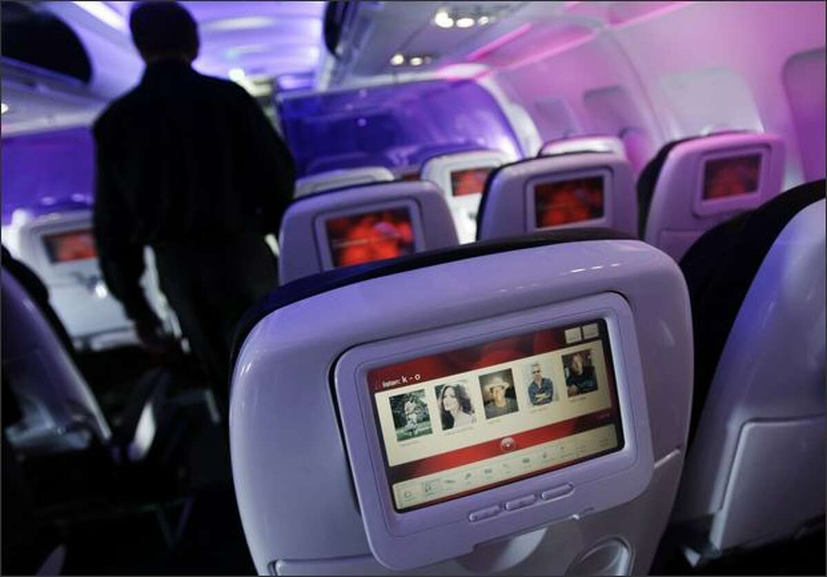 Virgin America landed its first flight from San Francisco to Seattle Tuesday at Seatac International Airport. The Virgin America Airbus 320 features purple-tinted mood lighting, power plugs, USB and ethernet jacks at every seat and 9-inch video touch-screens on every seatback with ability to custom order music, videos, movies and food, among other amenities.