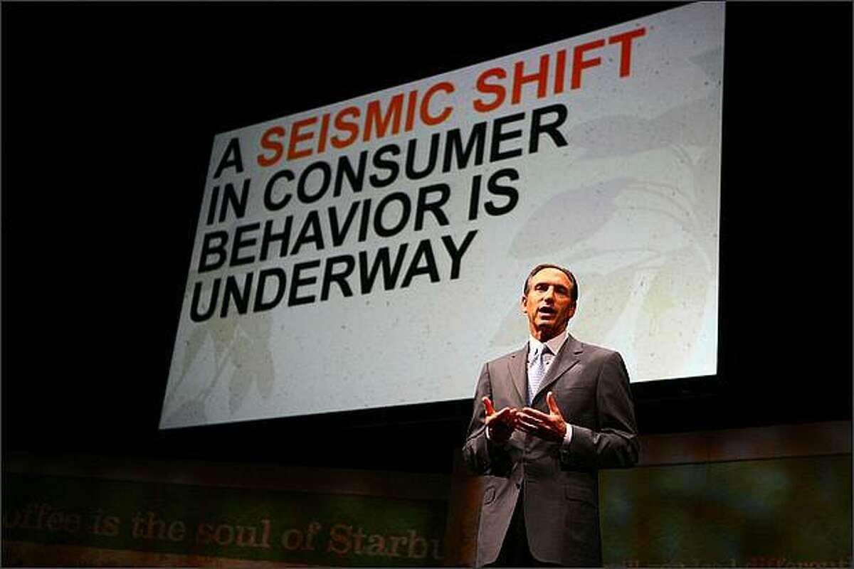 Starbucks Chairman Howard Schultz addresses shareholders at the company's annual meeting.