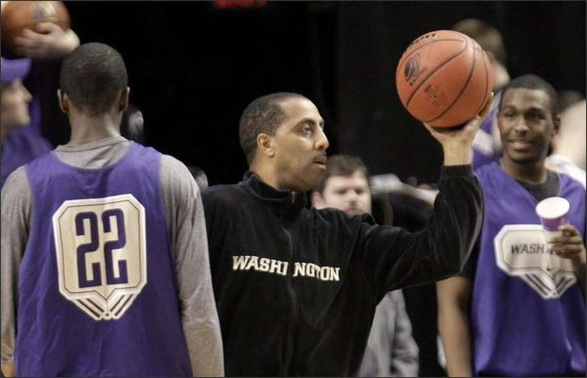 Washington head coach Lorenzo Romar conducts practice with his team Wednesday, March 18, 2009, at the Rose Garden in Portland, Ore. Washington faces Mississippi State in the first round of the NCAA tournament on Thursday. (AP Photo/Rick Bowmer)