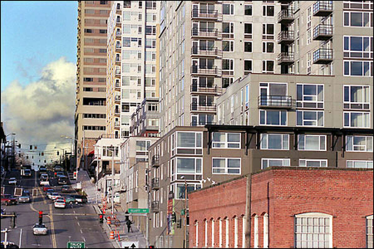The Olympus' two squat towers, in the center of this photo, fill the entire block south of Broad Street between Western and Elliott avenues.