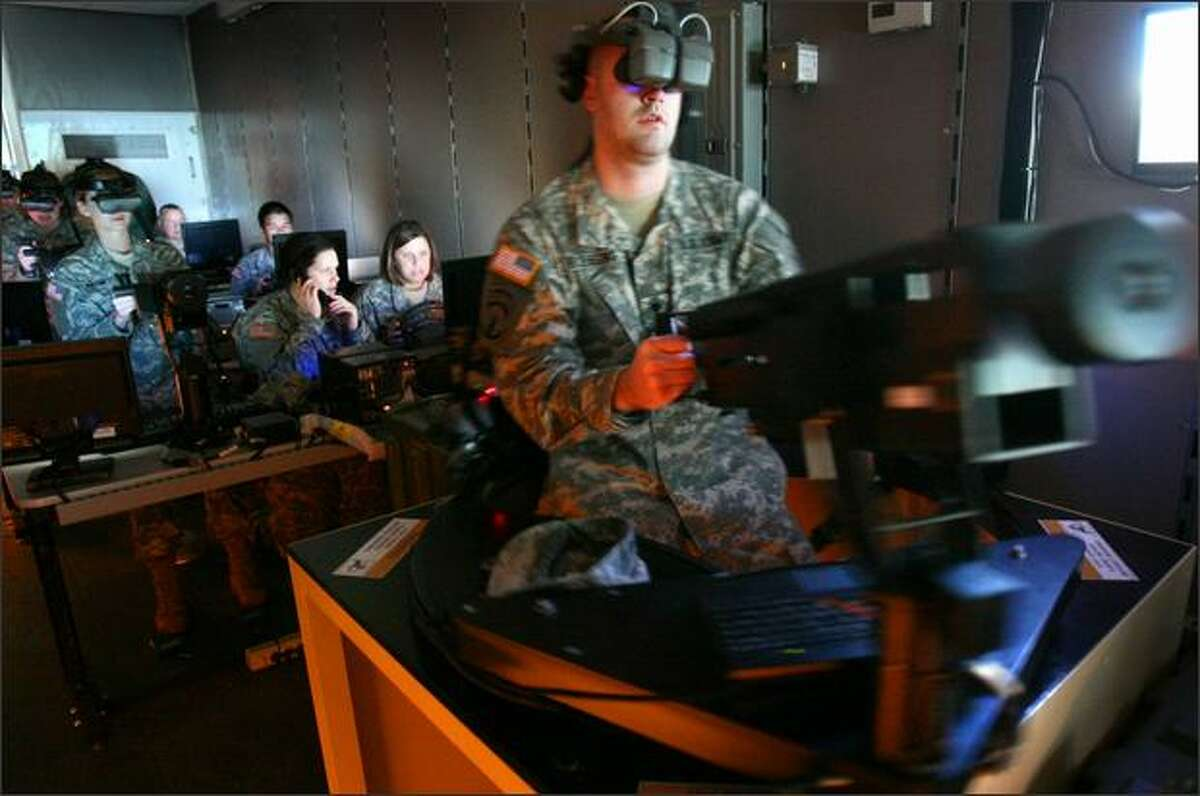 Spc. Chris Blessing operates a simulated turret-mounted gun in a trainer at the Interbay National Guard Armory earlier this month.