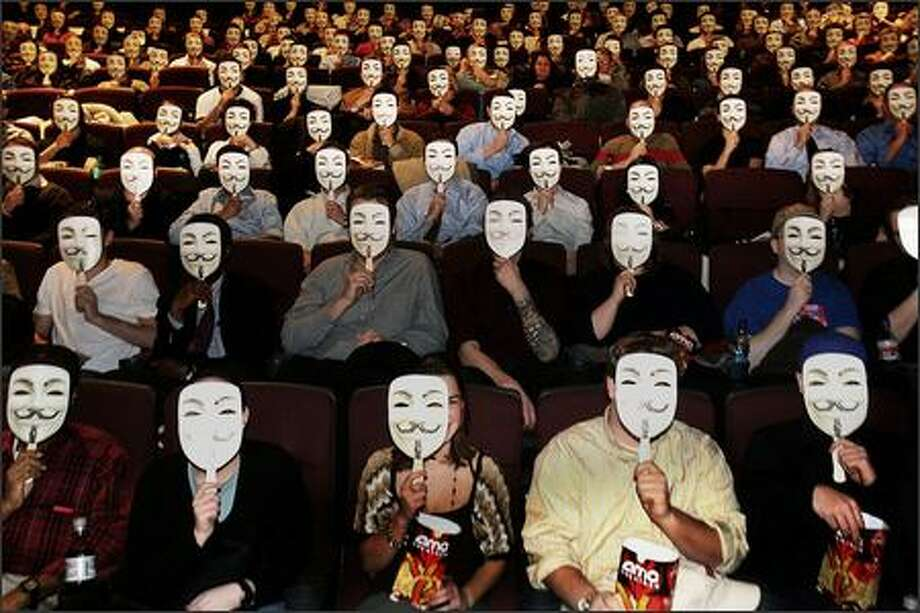 "It has been years since ""Being John Malkovich"" and ""Scream"" (No. 1) gave us a good mask gimmick, but ""V for Vendetta"" has taken up the torch, as shown by this New York audience wearing ""V"" masks during the film's opening weekend. Photo: Associated Press / Associated Press"