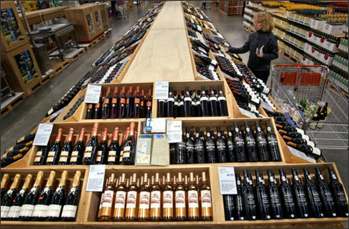Linda Stoner browses the wine selection at a Costco Wholesale in Seattle.