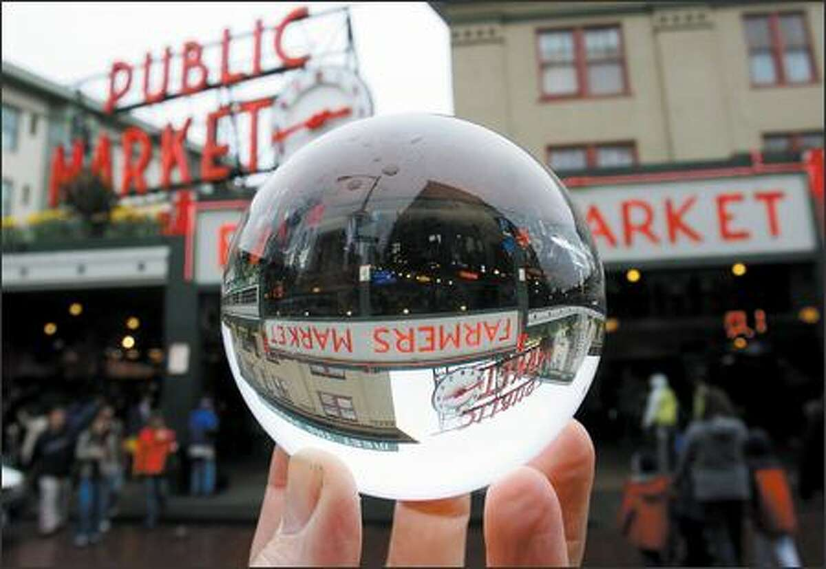 You can buy almost anything, including carrots, kites and crystal balls, at Pike Place Market in Seattle. The Market celebrates its centennial starting today.