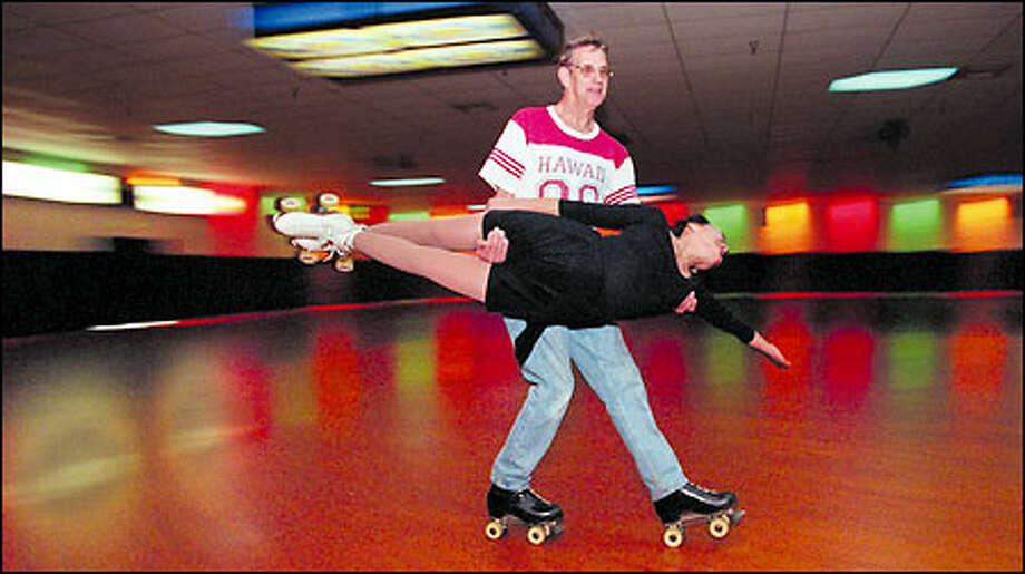 Fiftysomething Kiyomi Taketa sails around the rink with the greatest of ease in the sure hands of sixtysomething Mike Ozanich at the Pattison's West Skating Center in Federal Way. Photo: Grant M. Haller, Seattle Post-Intelligencer / Seattle Post-Intelligencer