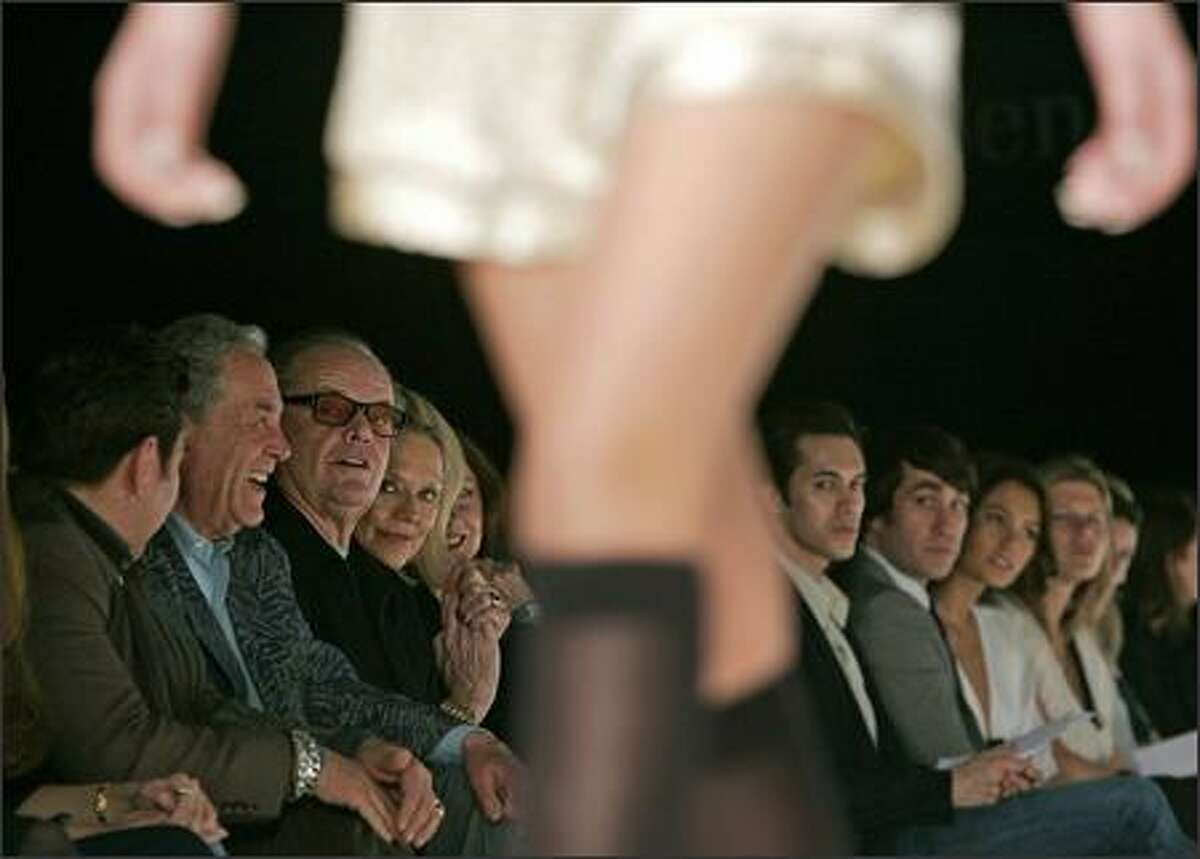 Jack Nicholson, third left, watches a model walk the runway. (AP Photo/Kevork Djansezian)