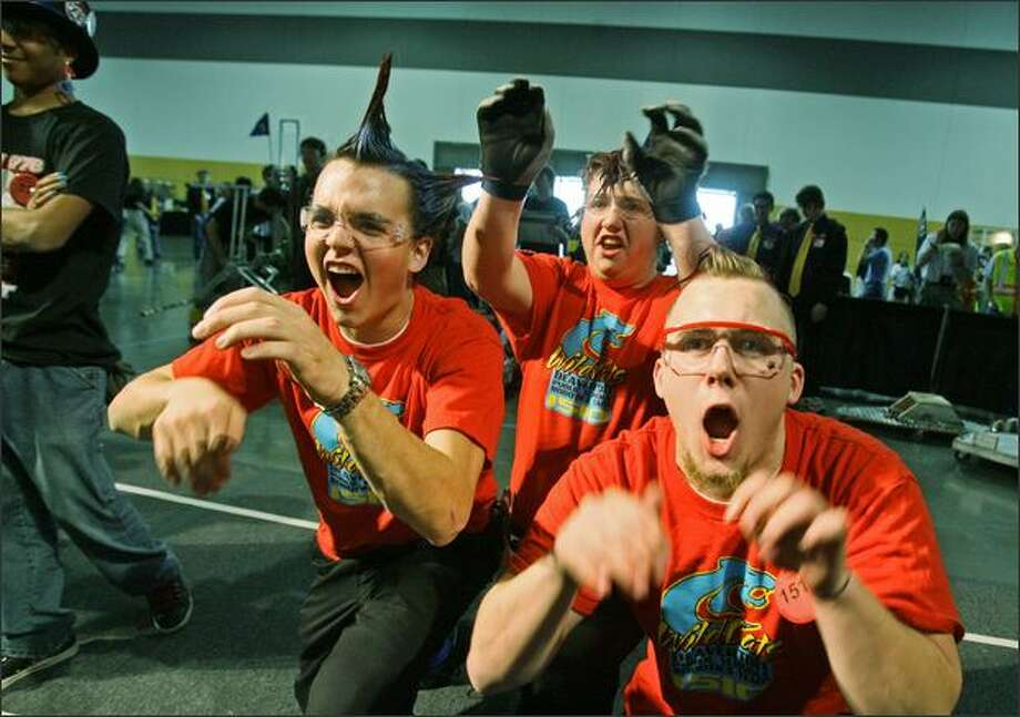 David Cobbley, left, Victor Bingham and Brent Pugh from Beaverton, Ore., are introduced Friday before a bout at the FIRST Robotics Competition. Photo: Dan DeLong, Seattle Post-Intelligencer / Seattle Post-Intelligencer