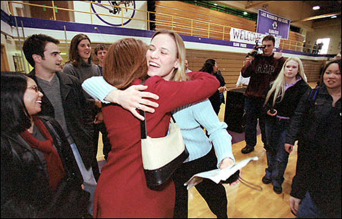 Olympic gold-medalist Jill Bakken is greeted by friends during a visit this week to her high school, Lake Washington in Kirkland. Last month in Salt Lake City, Bakken and Vonetta Flowers won the first-ever Olympic competition in women's bobsled. Bakken drove the sled, and Flowers was the pusher.