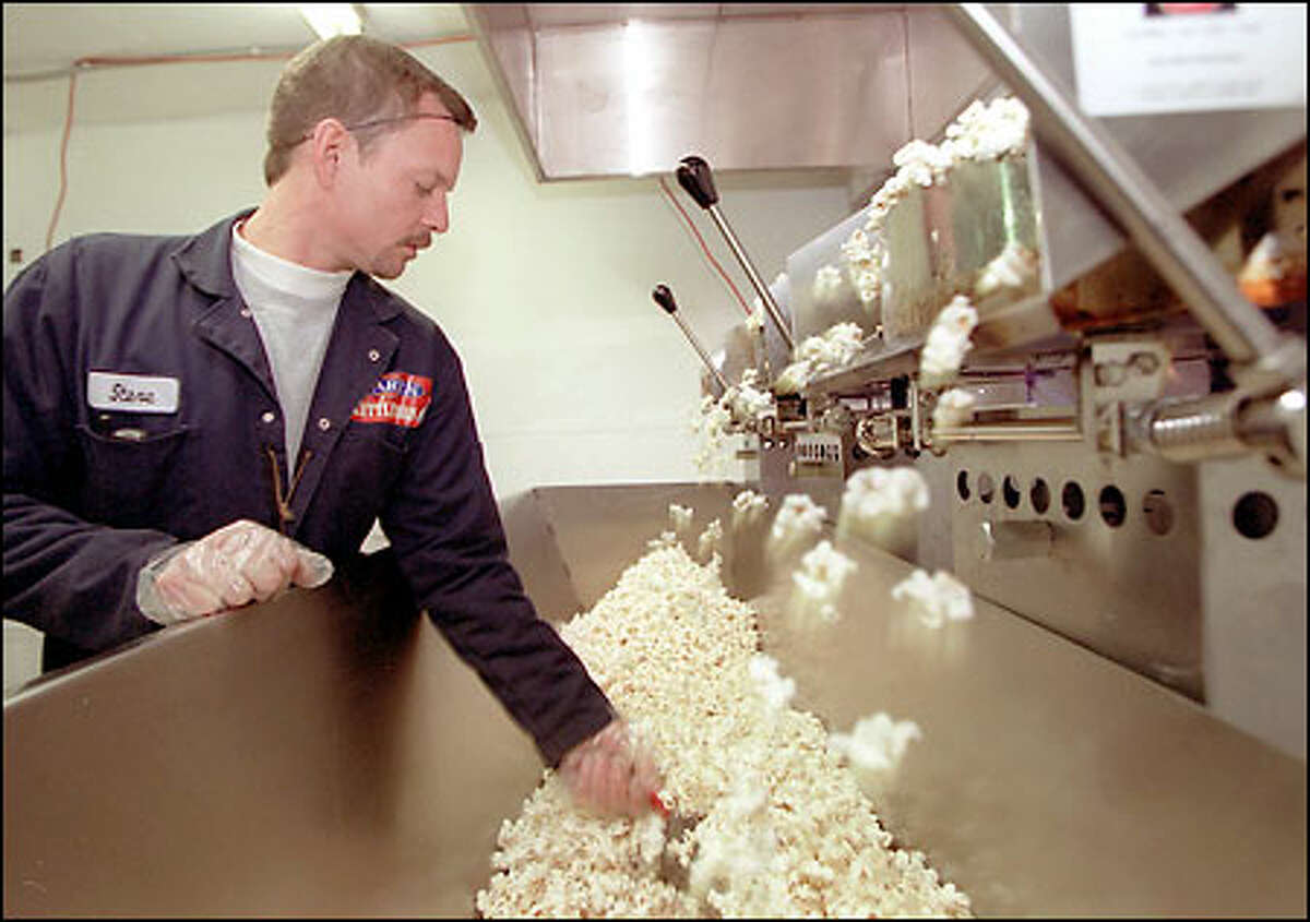 A passion for popcorn ... Steve Marek, who owns Marek Kettle Corn with his wife, Kristin, pops some of his product in his South Seattle plant.