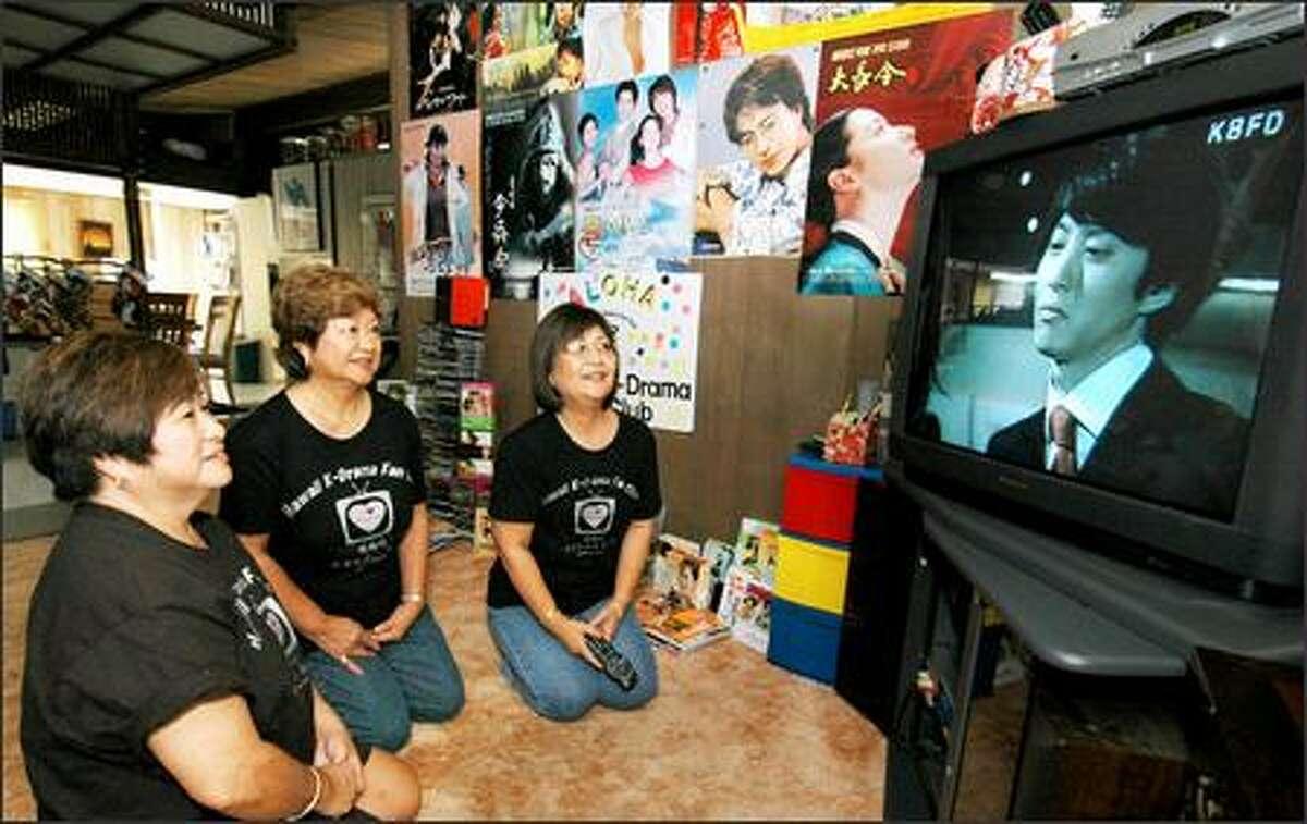 Margie Okuhara, Jane Sugita and Nora Muramoto, from left, members of the Hawaii K-Drama Fan Club, watch a Korean DVD at Muramoto's home in Pearl City, Hawaii.