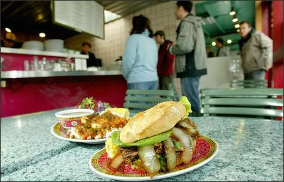 The food is Caribbean-Cuban and the atmosphere is relaxed. Choices include 11 sandwiches on toasted baguettes slathered with aioli, cilantro and onions. Photo: Paul Joseph Brown, Seattle Post-Intelligencer / Seattle Post-Intelligencer
