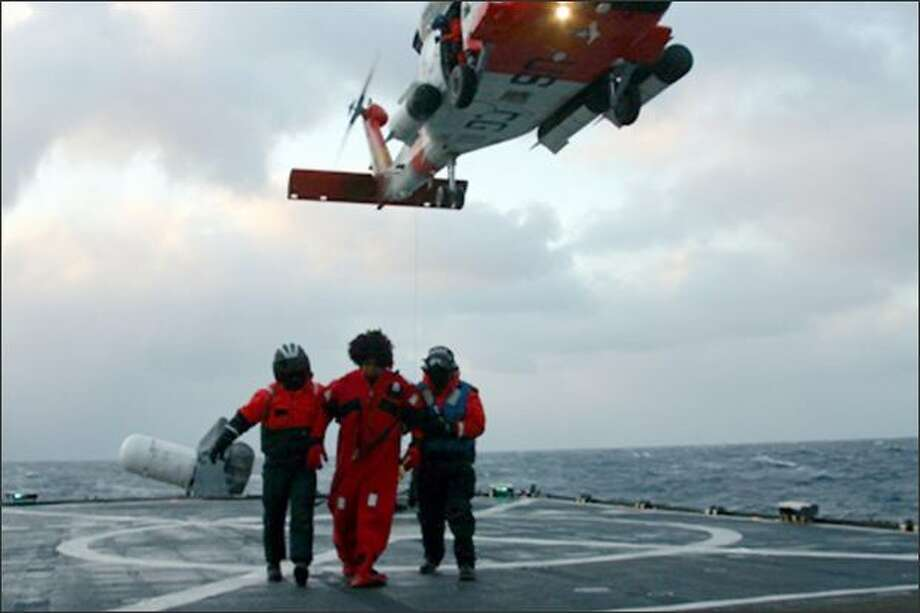 A crew member of the Alaska Ranger is taken on board the Coast Guard Cutter Munro. The Alaska Ranger began taking on water 120 miles west of Dutch Harbor. Photo: U.S. Coast Guard / U.S. Coast Guard