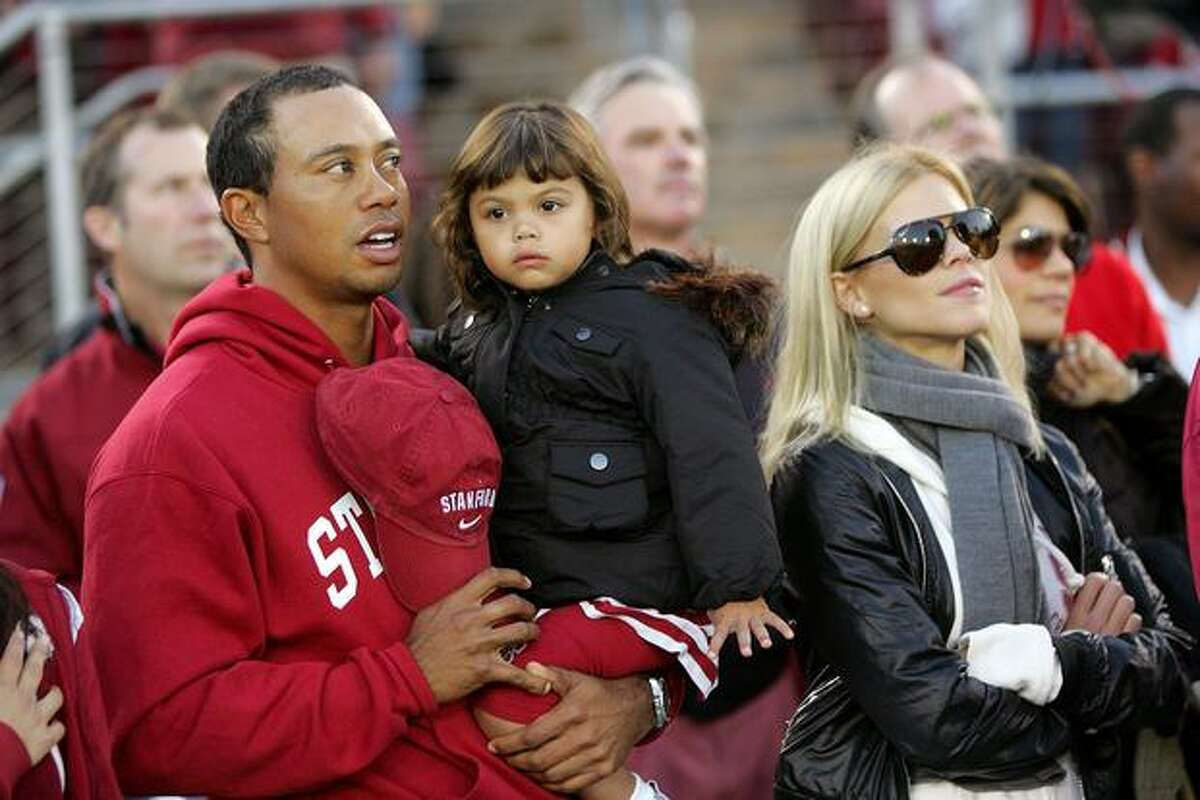 Tiger Woods, his daughter, Sam, and wife, Elin Nordegren, stand on the sidelines before the Stanford-Cal football game on Nov. 21, 2009 in Palo Alto, Calif. Four days later, the story broke about his infidelity.