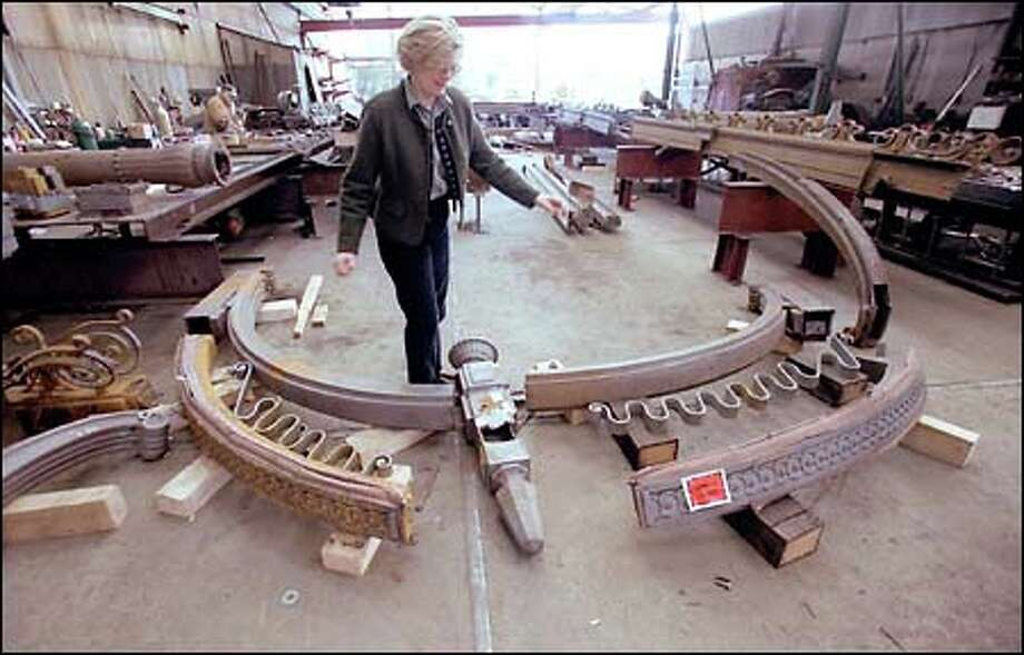 Heidi Seidelhuber's company, Seidelhuber Iron and Bronze Works, will fit back together thousands of pergola pieces. Photo: Gilbert W. Arias, Seattle Post-Intelligencer / Seattle Post-Intelligencer