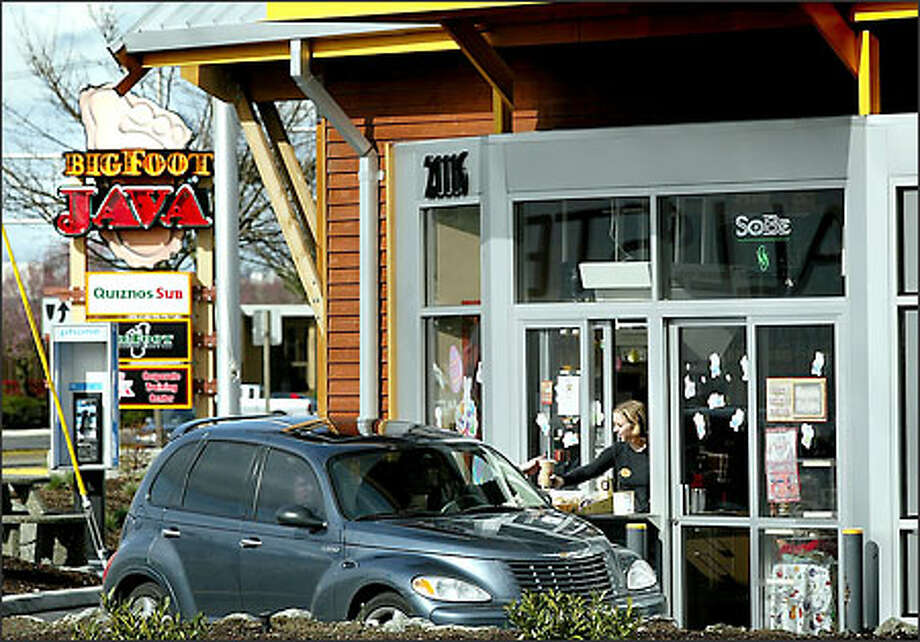 The drive-thru at South 212th Street and 84th Avenue South in Kent is one of six Bigfoot Java outlets offering caffeine connoisseurs a jolt to keep them rockin' around the clock. Photo: Dan DeLong, Seattle Post-Intelligencer / Seattle Post-Intelligencer