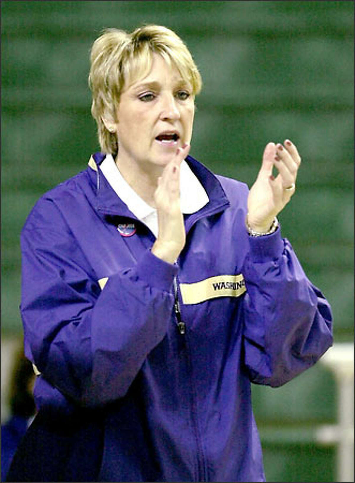 Coach June Daugherty believes returning players and an influx of newcomers and red-shirts will make the 2003-04 UW women's team