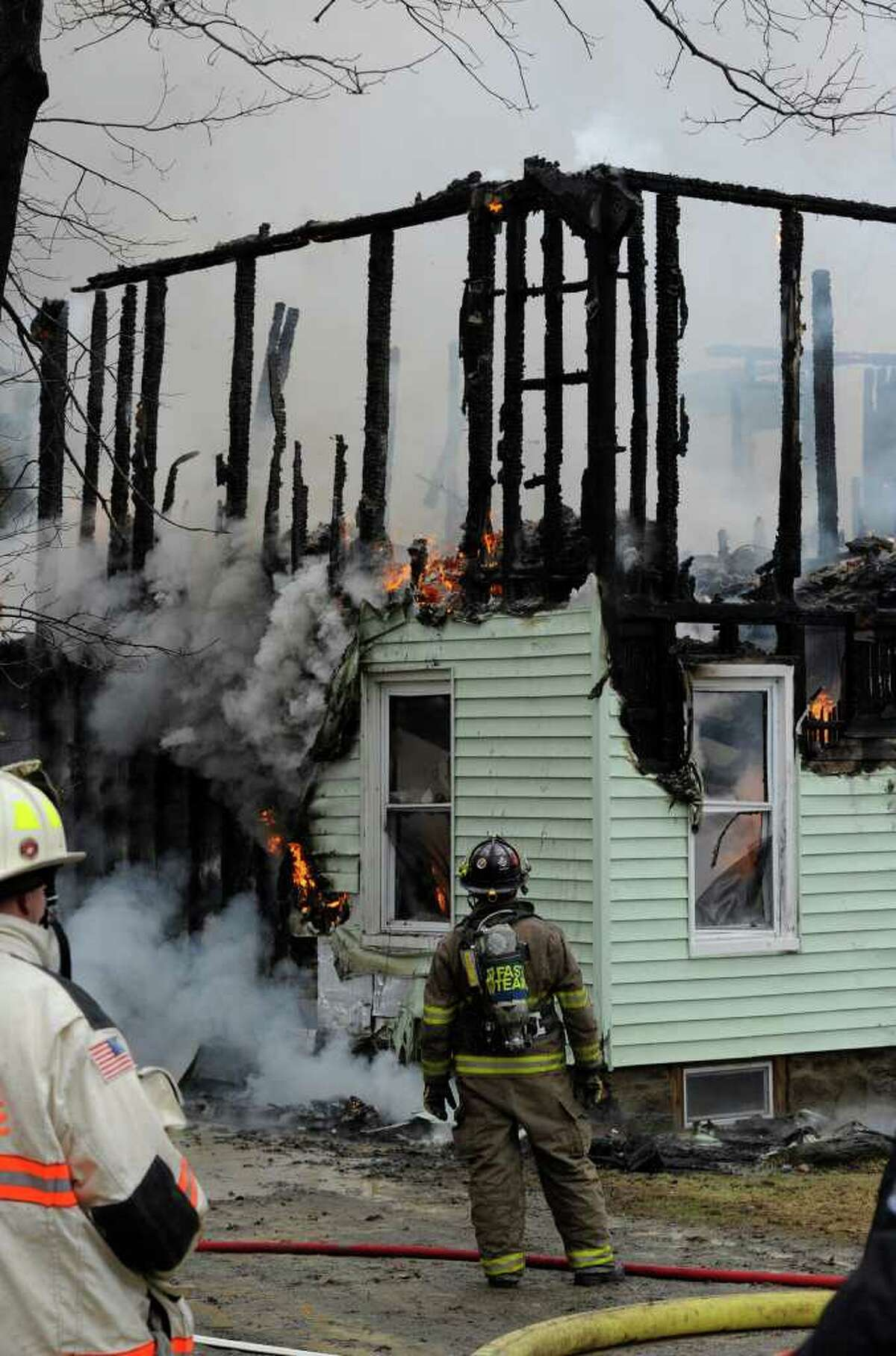 Despite efforts by several fire companies, a fire consumed 33 Matala Lane in Pittstown, N.Y., on Tuesday, April 5, 2011. (Skip Dickstein / Times Union))
